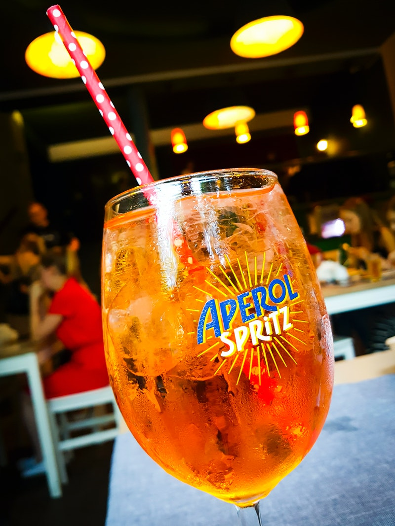 Aperol Spritz drink is served indoors a restaurant in Krakow, Poland, on 8 August 2019.  (Photo by B...