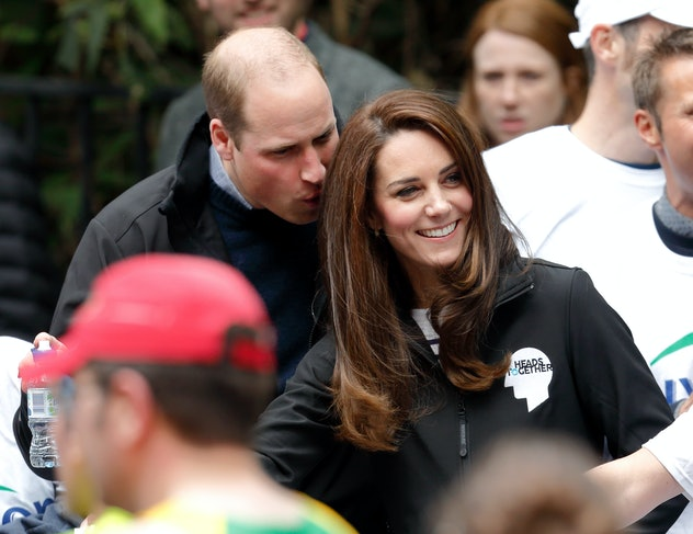Prince William whispers to Kate Middleton.