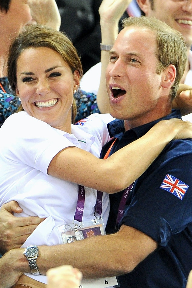 Kate Middleton and Prince William share a hug at the 2012 Olympics.