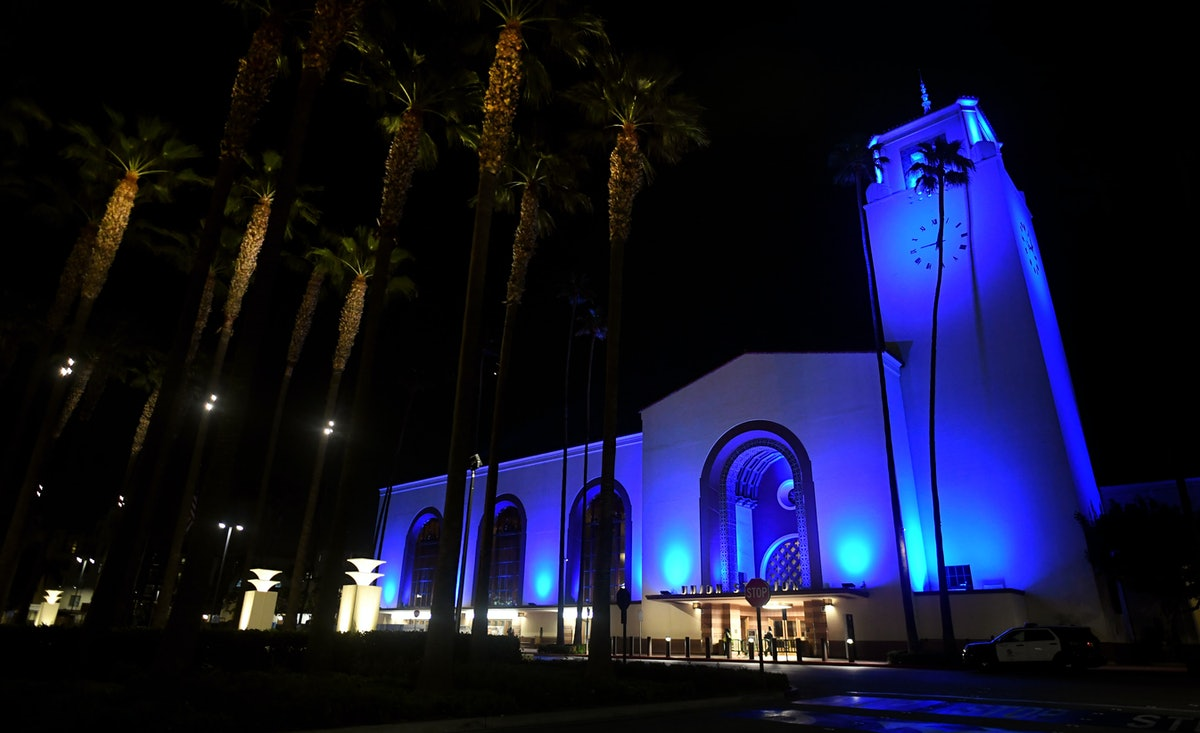 LOS ANGELES, CA - APRIL 16:   Union Station is lit up blue along with more than 100 major sporting a...