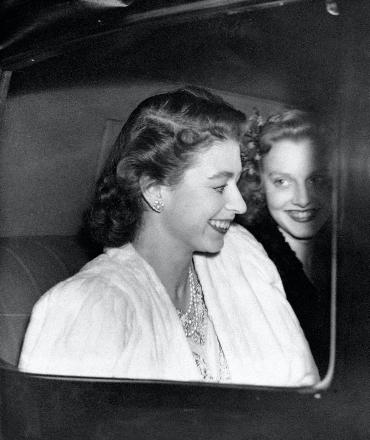 Princess Elizabeth driving from Buckingham Palace, the day before the announcement by the King of the engagement of Princess Elizabeth and Lieutenant Philip Mountbatten.   (Photo by PA Images via Getty Images)