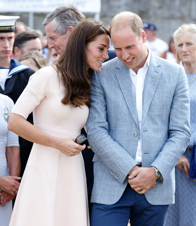Kate Middleton whispers to Prince William.