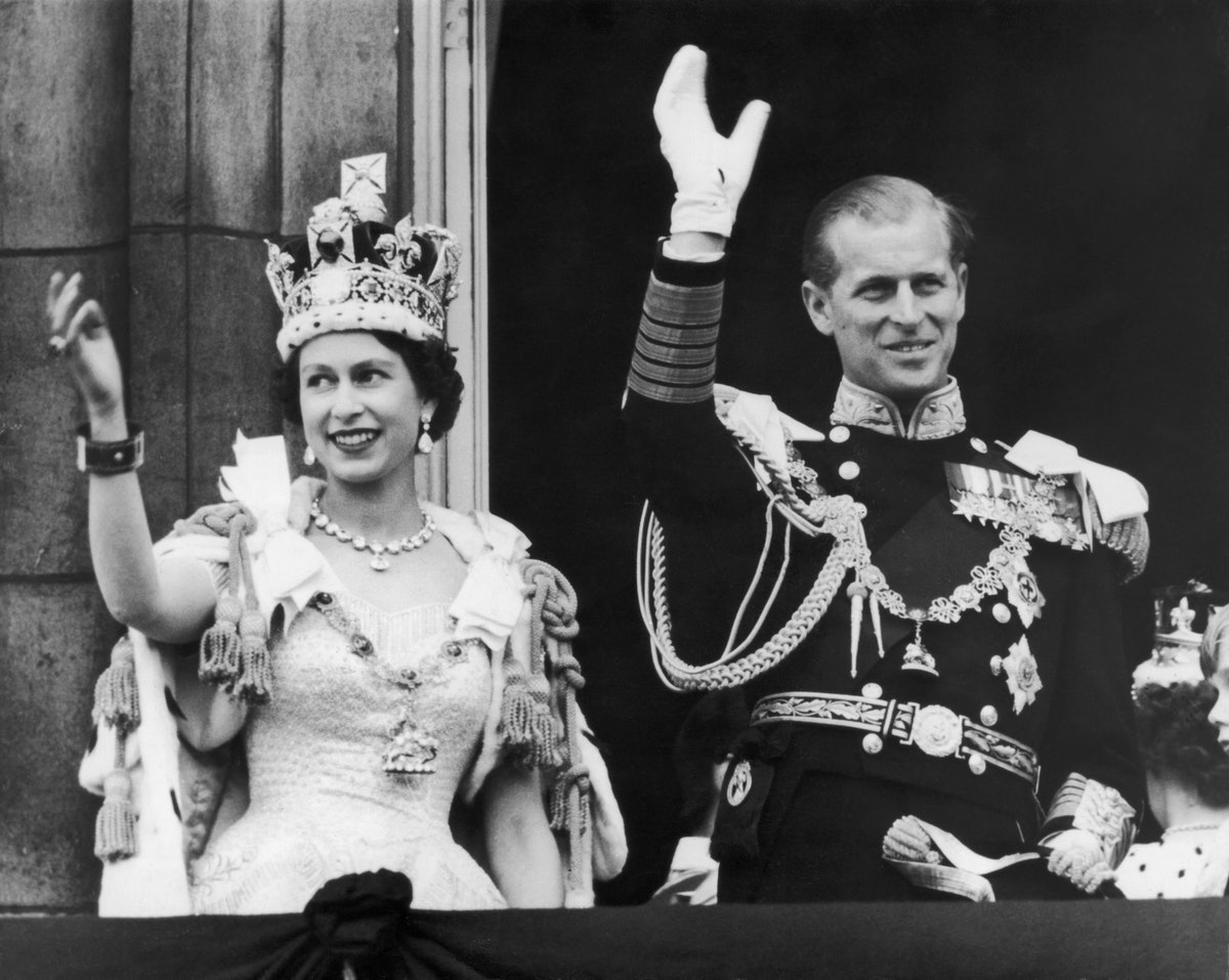 Queen Elizabeth II and the Duke of Edinburgh wave at the crowds from the balcony at Buckingham Palac...
