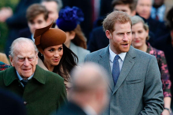 (L-R) Britain's Prince Philip, Duke of Edinburgh, US actress and fiancee of Britain's Prince Harry Meghan Markle and Britain's Prince Harry arrive to attend the Royal Family's traditional Christmas Day church service at St Mary Magdalene Church in Sandringham, Norfolk, eastern England, on December 25, 2017. (Photo by Adrian DENNIS / AFP) (Photo by ADRIAN DENNIS/AFP via Getty Images)