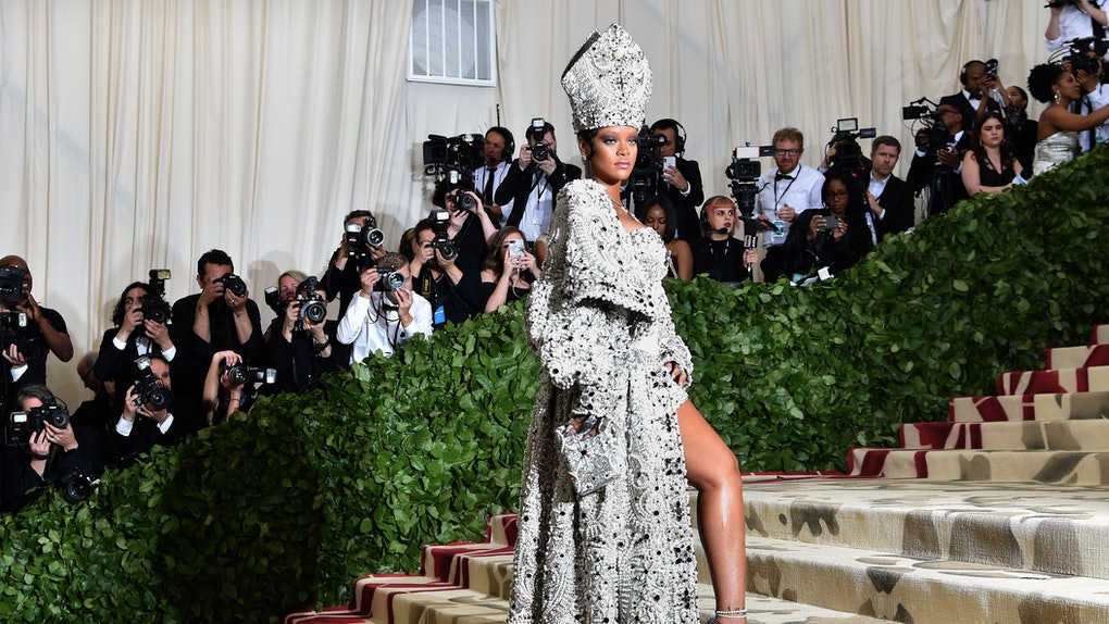 TOPSHOT - Rihanna arrives for the 2018 Met Gala on May 7, 2018, at the Metropolitan Museum of Art in New York. - The Gala raises money for the Metropolitan Museum of Arts Costume Institute. The Gala's 2018 theme is Heavenly Bodies: Fashion and the Catholic Imagination. (Photo by Hector RETAMAL / AFP)        (Photo credit should read HECTOR RETAMAL/AFP via Getty Images)