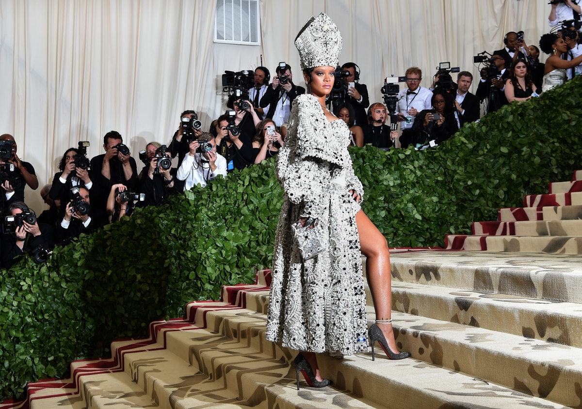 TOPSHOT - Rihanna arrives for the 2018 Met Gala on May 7, 2018, at the Metropolitan Museum of Art in...