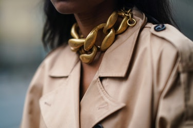 PARIS, FRANCE - JANUARY 27: Emilie Joseph wears a golden large chain necklace from JW Anderson, a beige pale brown long trench coat from Gestuz, on January 27, 2021 in Paris, France. (Photo by Edward Berthelot/Getty Images)