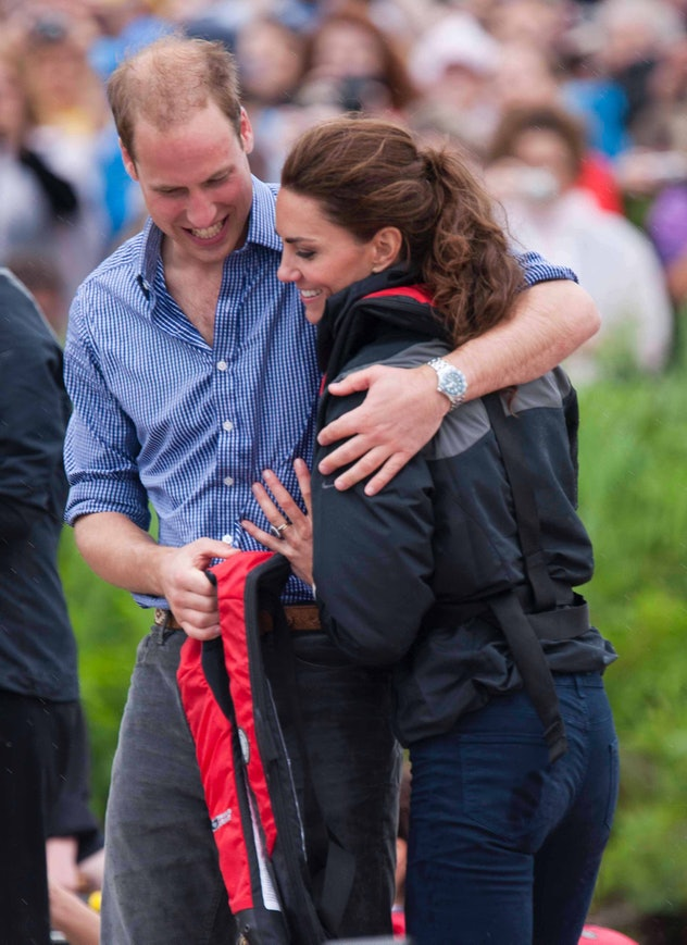 Prince William hugs Kate Middleton in Canada.