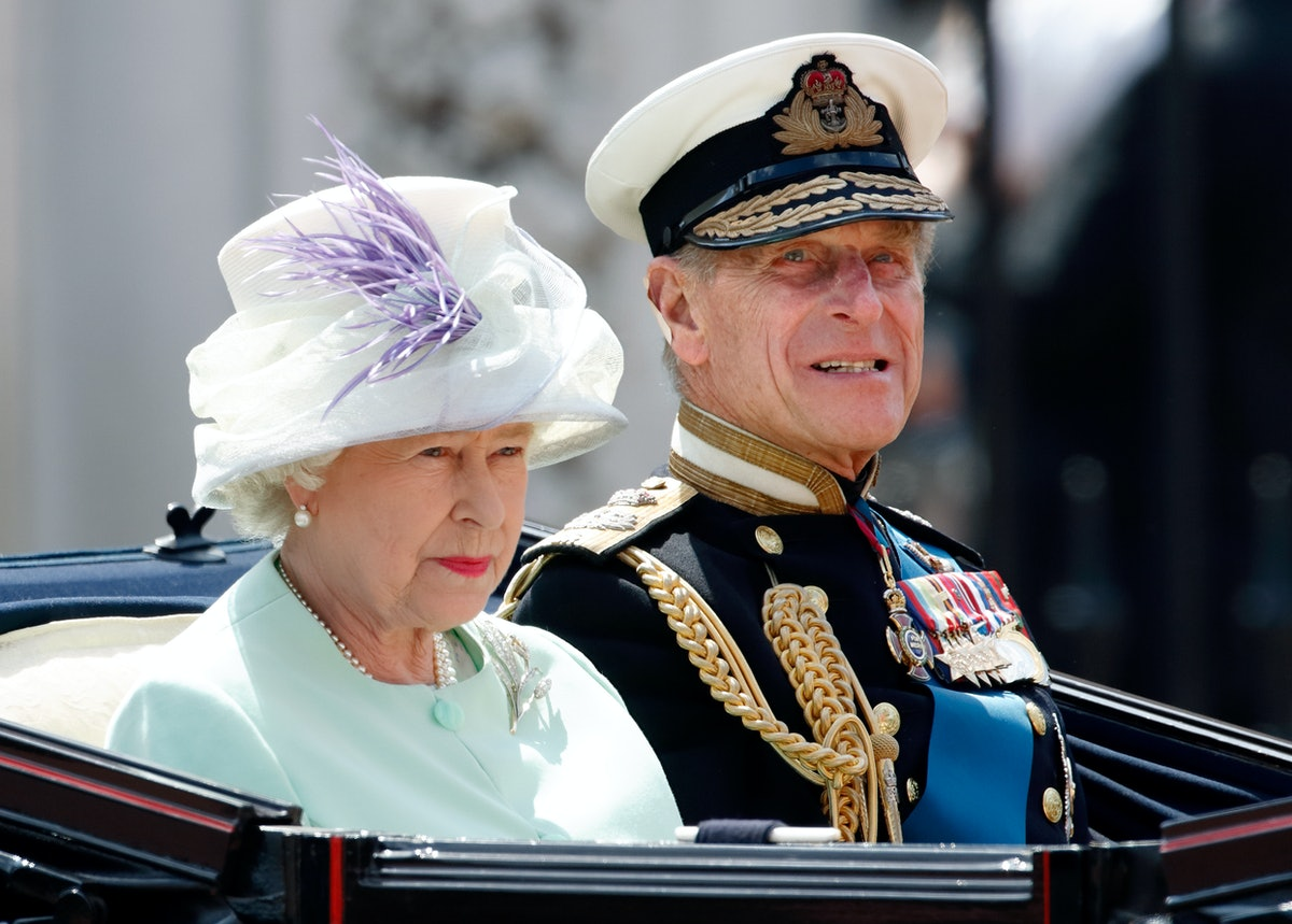 LONDON, UNITED KINGDOM - JULY 10: (EMBARGOED FOR PUBLICATION IN UK NEWSPAPERS UNTIL 24 HOURS AFTER CREATE DATE AND TIME) Queen Elizabeth II and Prince Philip, Duke of Edinburgh travel down The Mall in a horse drawn carriage ahead of a Battle of Britain Memorial Flight fly-past on Commemoration Day, marking the 60th anniversary of the end of World War II on July 10, 2005 in London, England. (Photo by Max Mumby/Indigo/Getty Images)