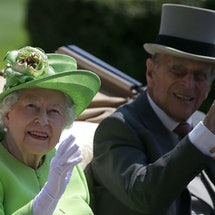 Britain's Queen Elizabeth II and her husband Britain's Prince Philip, Duke of Edinburgh travel by horse-drawn carriage as they arrive on day one of the Royal Ascot horse racing meet, in Ascot, west of London, on June 20, 2017. - The five-day meeting is one of the highlights of the horse racing calendar. Horse racing has been held at the famous Berkshire course since 1711 and tradition is a hallmark of the meeting. Top hats and tails remain compulsory in parts of the course while a daily procession of horse-drawn carriages brings the Queen to the course. (Photo by Daniel LEAL-OLIVAS / AFP) (Photo by DANIEL LEAL-OLIVAS/AFP via Getty Images)