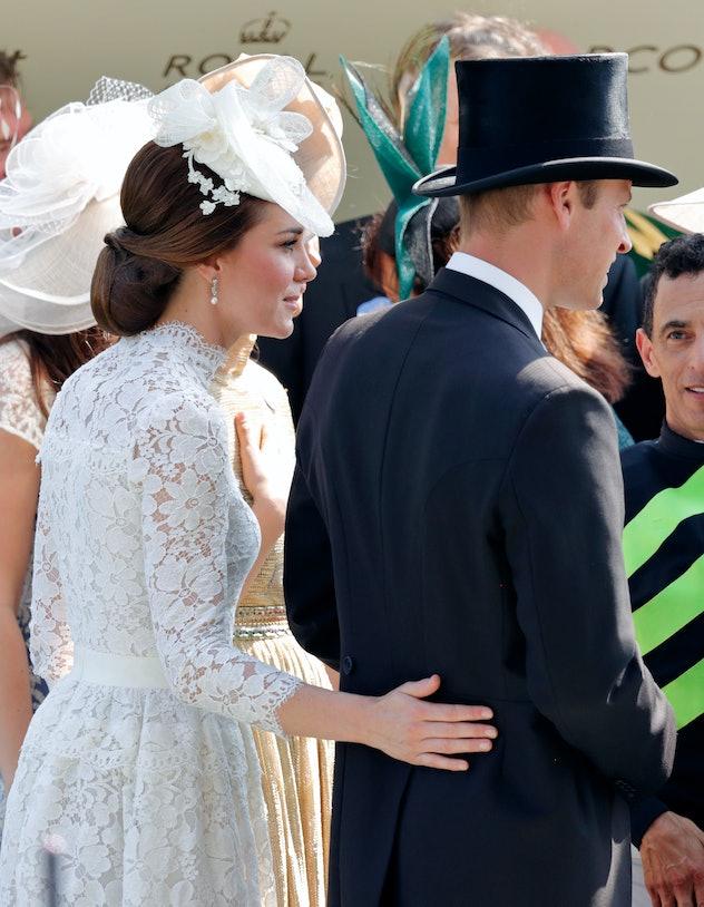 Kate Middleton wraps her arm around Prince William.