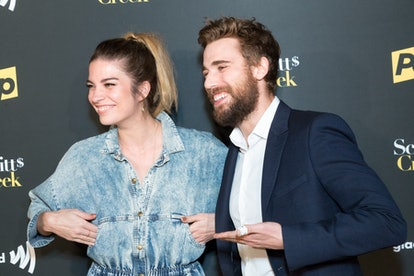 "HOLLYWOOD, CALIFORNIA - JANUARY 16:  Actors Annie Murpy and Dustin Milligan attend the Premiere Of Pop TV's ""Schitt's Creek"" Season 4 at ArcLight Hollywood on January 16, 2018 in Hollywood, California.  (Photo by Greg Doherty/Patrick McMullan via Getty Images)"