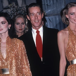 Halston (1932 - 1990) and the Halstonettes at a perfume launch held at Saks 5th Ave., New York, ca.1980s. (Photo by Rose Hartman/Getty Images)