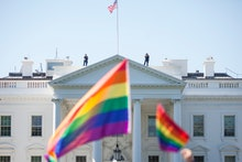 WASHINGTON, DC - JUNE 11:  Demonstrators carry rainbow flags past the White House during the Equalit...