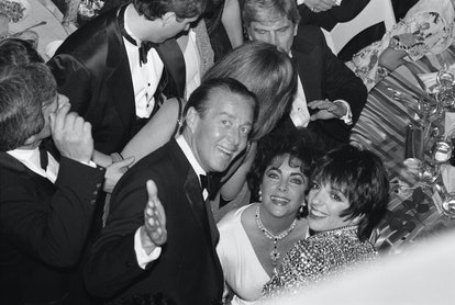 Fashion designer, Halston, actress Elizabeth Taylor and singer and actress Liza Minnelli smile at the opening night party for the Broadway revival of the play 'The Little Foxes.'