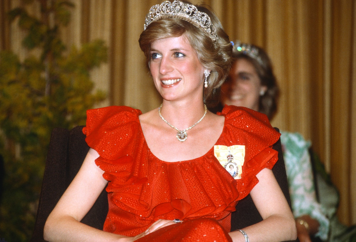 HOBART, AUSTRALIA - MARCH 30: Diana, Princess of Wales, wearing a red dress designed by Bruce Oldfield, the Spencer Tiara and the Royal Family Order of the Queen and the Prince of Wales feathers diamond necklace, smiles as she attends a reception at the Wrest Point Hotel on March 30, 1983 in Tasmania, Australia. (Photo by Anwar Hussein/Getty Images)