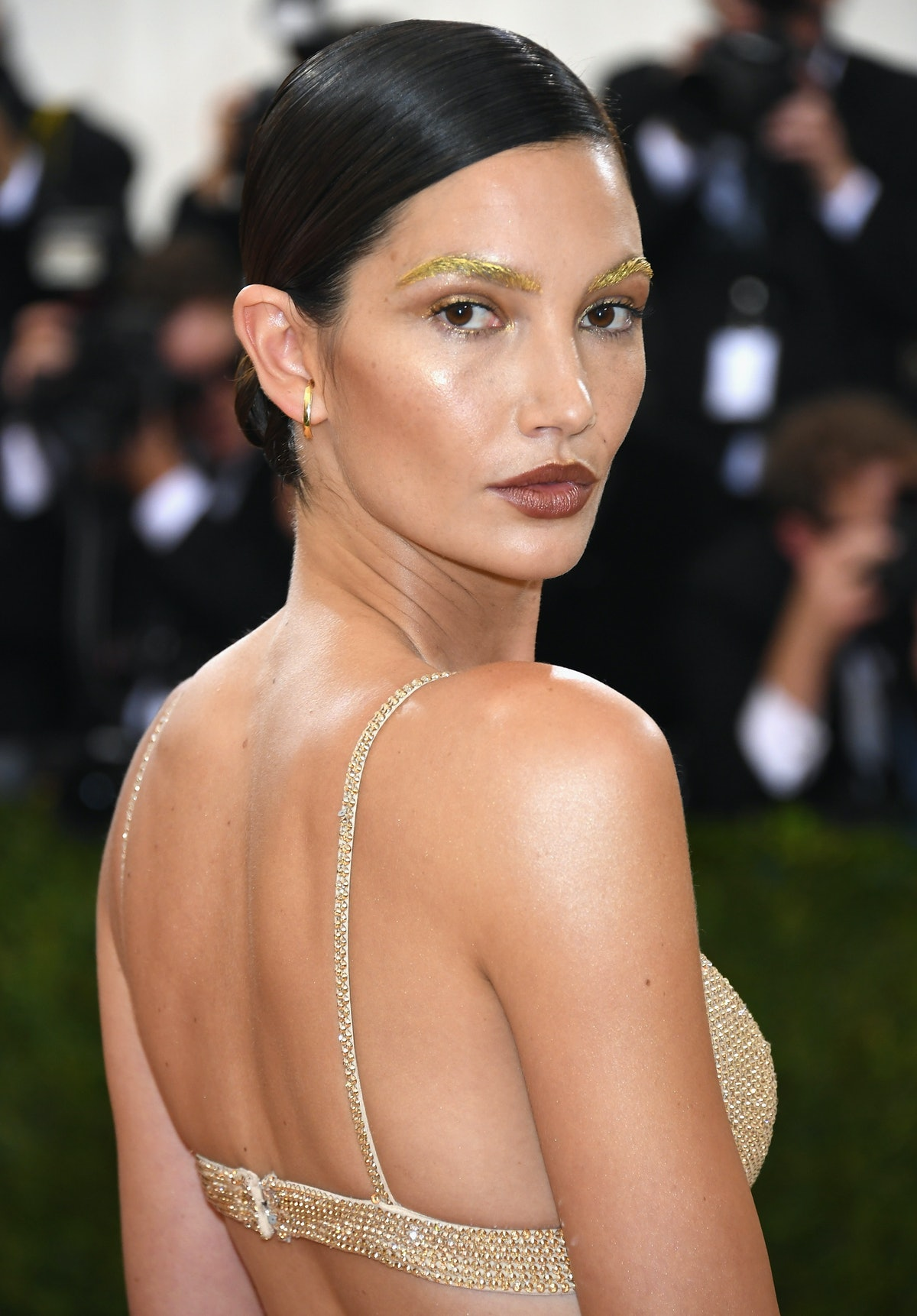 Lily Aldridge's daring look at the 2016 Met Gala perfectly complemented her gilded gown and sleek updo.
