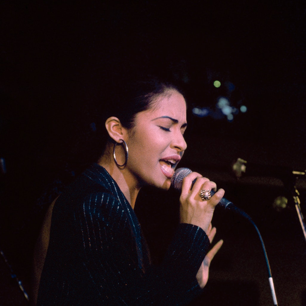 Singer Selena (Quintanilla) performs at the opening of the Hard Rock Cafe on January 12th, 1995 in San Antonio, Texas.  (Photo by Larry Busacca/Getty Images)