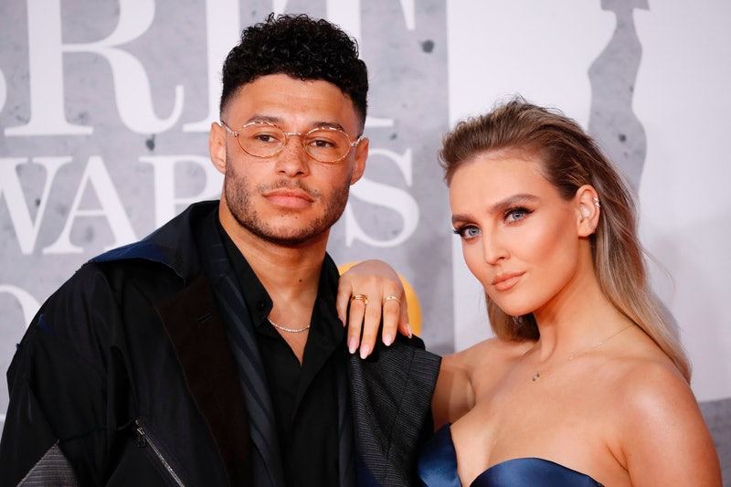 British footballer Alex Oxlade-Chamberlain and girlfriend Perrie Edwards (R) pose on the red carpet on arrival for the BRIT Awards 2019 in London on February 20, 2019. (Photo by Tolga AKMEN / AFP) / RESTRICTED TO EDITORIAL USE  NO POSTERS  NO MERCHANDISE NO USE IN PUBLICATIONS DEVOTED TO ARTISTS        (Photo credit should read TOLGA AKMEN/AFP via Getty Images)