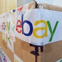 Close-up of the eBay logo featured on the packing tape securing a large cardboard shipping box in San Ramon, California, USA, November 8, 2020. (Photo by Smith Collection/Gado/Getty Images)