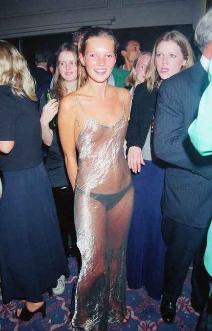 English supermodel Kate Moss wearing a diaphanous silver dress at the Elite Model Agency party for the Look of the Year Contest at the Hilton Hotel, London, September 1993. (Photo by Dave Benett/Getty Images)