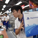 An employee of an electronics retail shop sells the new Sony PlayStation virtual reality (PSVR) headset before its opening in Tokyo on October 13, 2016.  The electronics giant - which has been leaning on its videogames business to claw back to profitability - started selling its PlayStation virtual reality (PSVR) headset on October 13 in the Japanese domestic market and North America. / AFP / KAZUHIRO NOGI        (Photo credit should read KAZUHIRO NOGI/AFP via Getty Images)