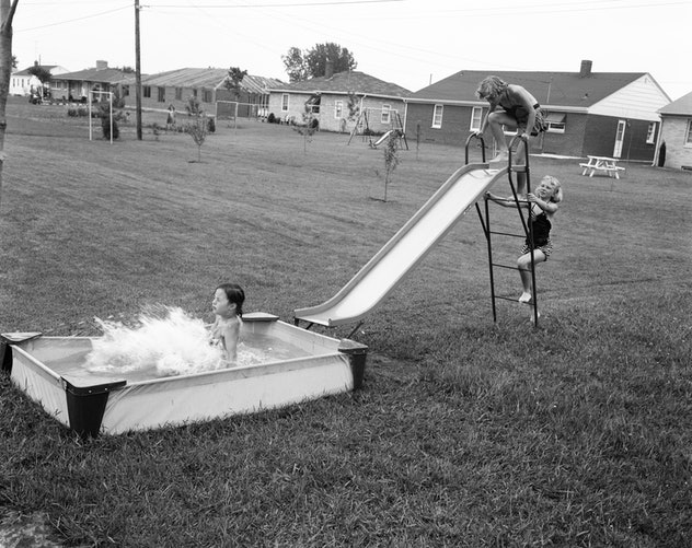 A homemade slip and slide in the 1950s.