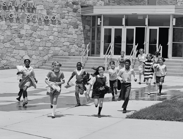 A 1960s school lets out for summer.