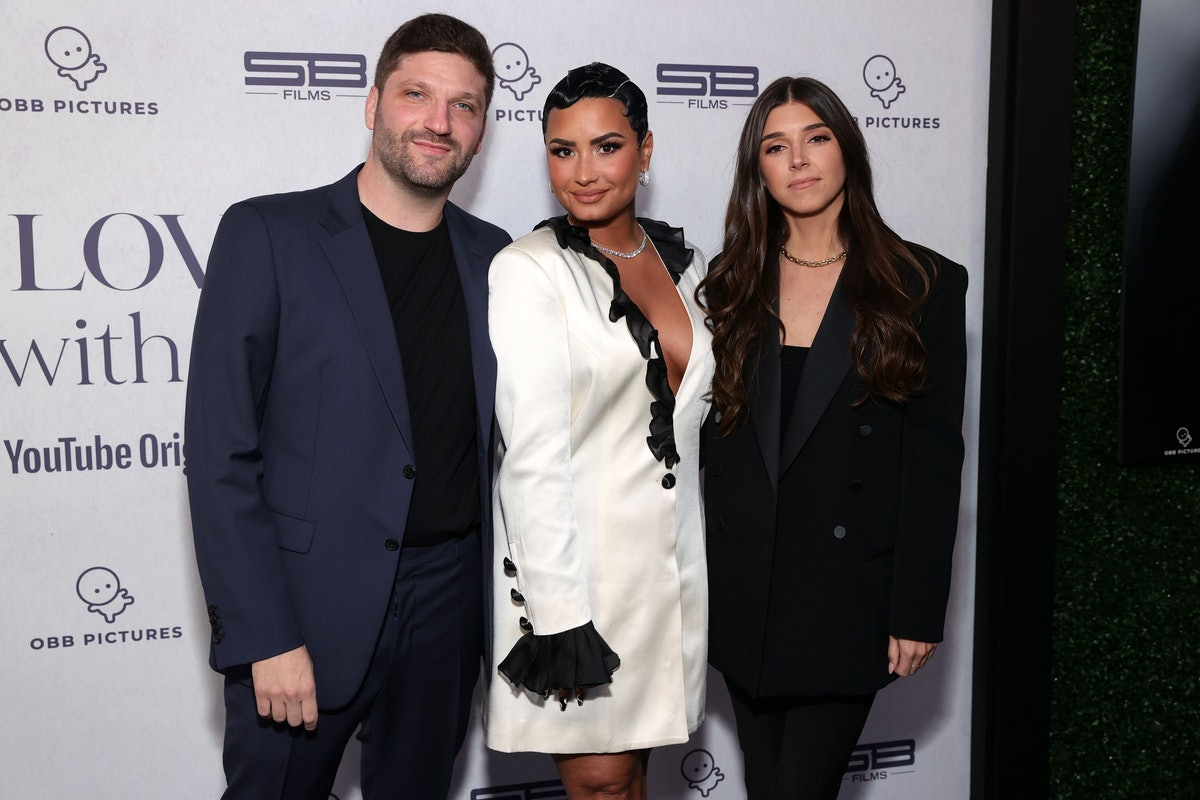 """BEVERLY HILLS, CALIFORNIA - MARCH 22: (L-R) Michael D. Ratner, Director/Executive Producer OBB Pictures, Demi Lovato and Lauren Rothberg attend the OBB Premiere Event for YouTube Originals Docuseries """"Demi Lovato: Dancing With The Devil"""" at The Beverly Hilton on March 22, 2021 in Beverly Hills, California. (Photo by Rich Fury/Getty Images for OBB Media)"""