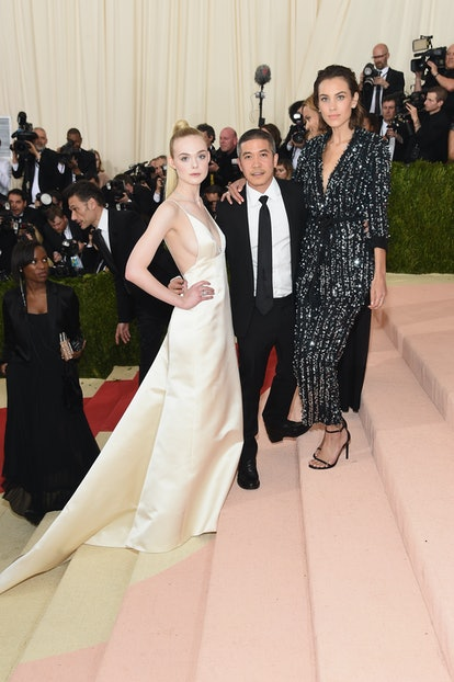 """NEW YORK, NY - MAY 02:  Elle Fanning, Thakoon Panichgul, and Alexa Chung attend the """"Manus x Machina: Fashion In An Age Of Technology"""" Costume Institute Gala at Metropolitan Museum of Art on May 2, 2016 in New York City.  (Photo by Jamie McCarthy/FilmMagic)"""