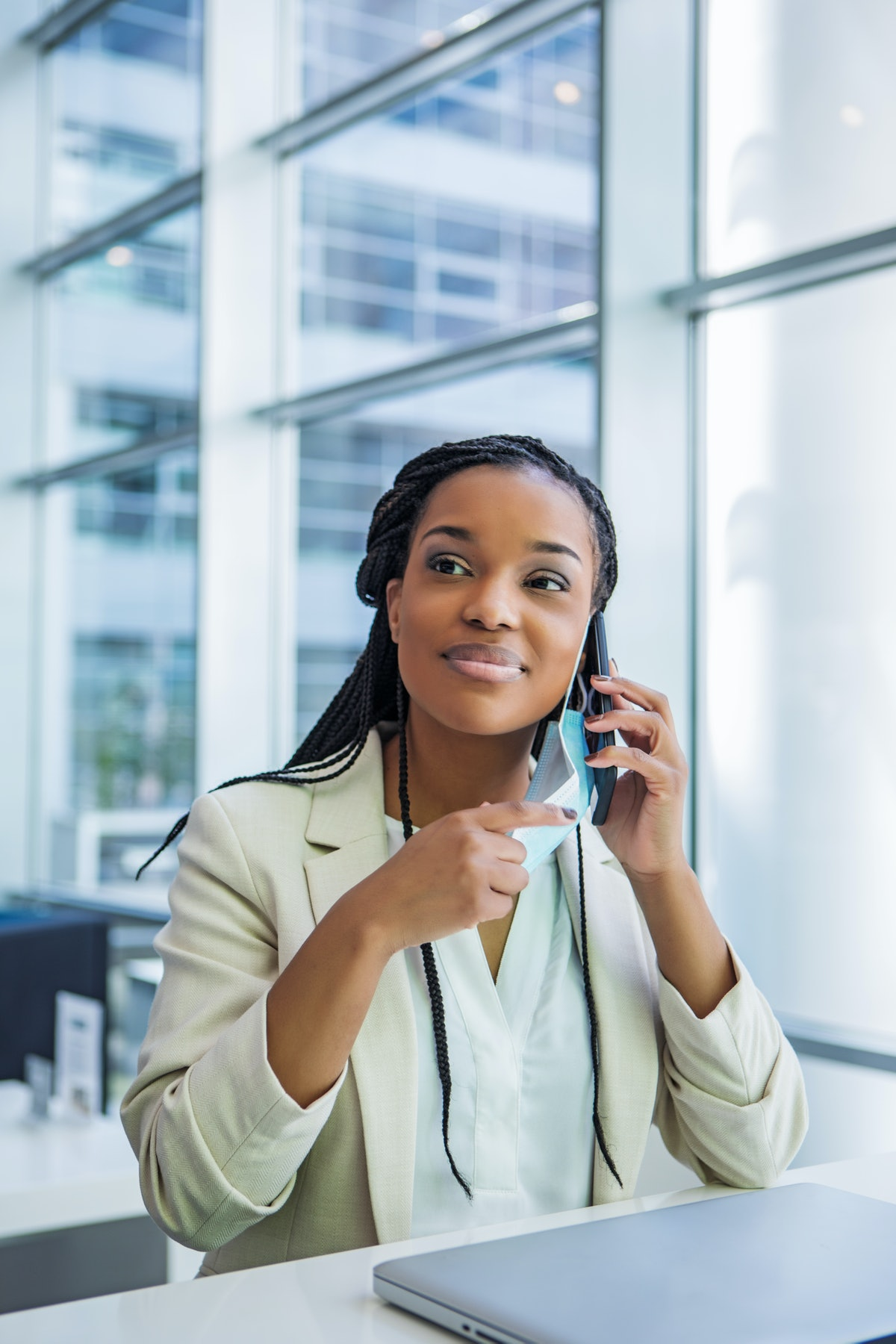 A portrait of a beautiful young black ethnicity female business woman back in the office after lockd...