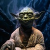 A life-size figurine of Yoda from the Star Wars series is displayed at the Star Wars Identities exhibition during a media preview at the ArtScience Museum in Singapore on January 28, 2021. (Photo by ROSLAN RAHMAN / AFP) (Photo by ROSLAN RAHMAN/AFP via Getty Images)