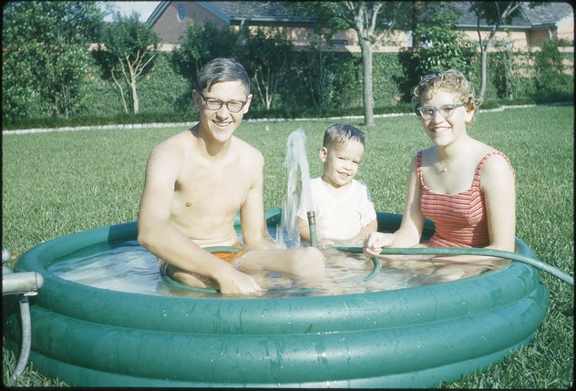A family enjoying an inflatable pool.
