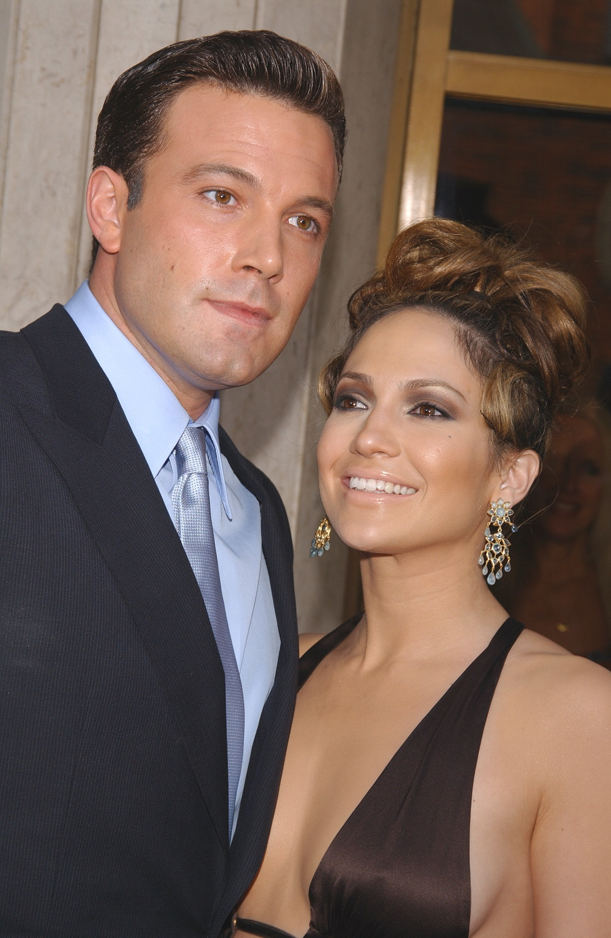 """Ben Affleck and Jennifer Lopez arriving at the premiere of """"Gigli"""". (Photo by Frank Trapper/Corbis via Getty Images)"""