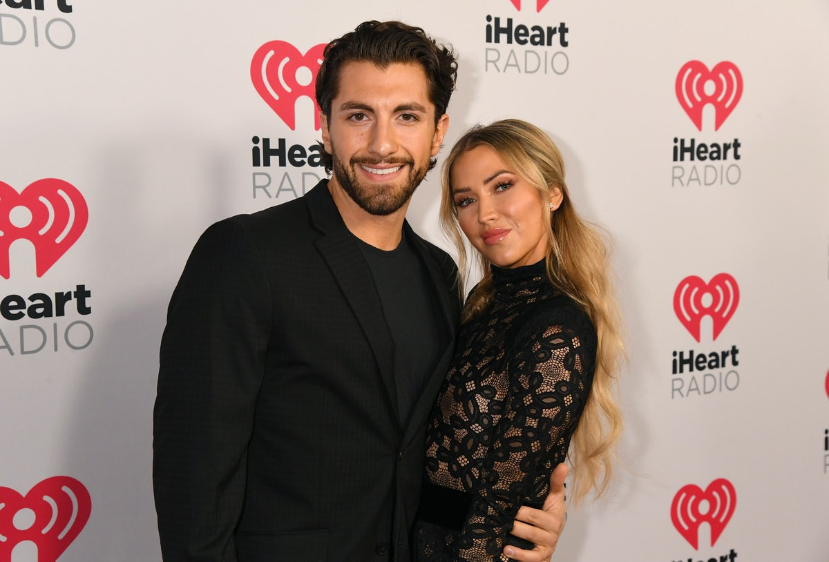 BURBANK, CALIFORNIA - JANUARY 17: (FOR EDITORIAL USE ONLY) (L-R) Jason Tartick and Kaitlyn Bristowe attend the 2020 iHeartRadio Podcast Awards at the iHeartRadio Theater on January 17, 2020 in Burbank, California. (Photo by Jeff Kravitz/FilmMagic for iHeartMedia)