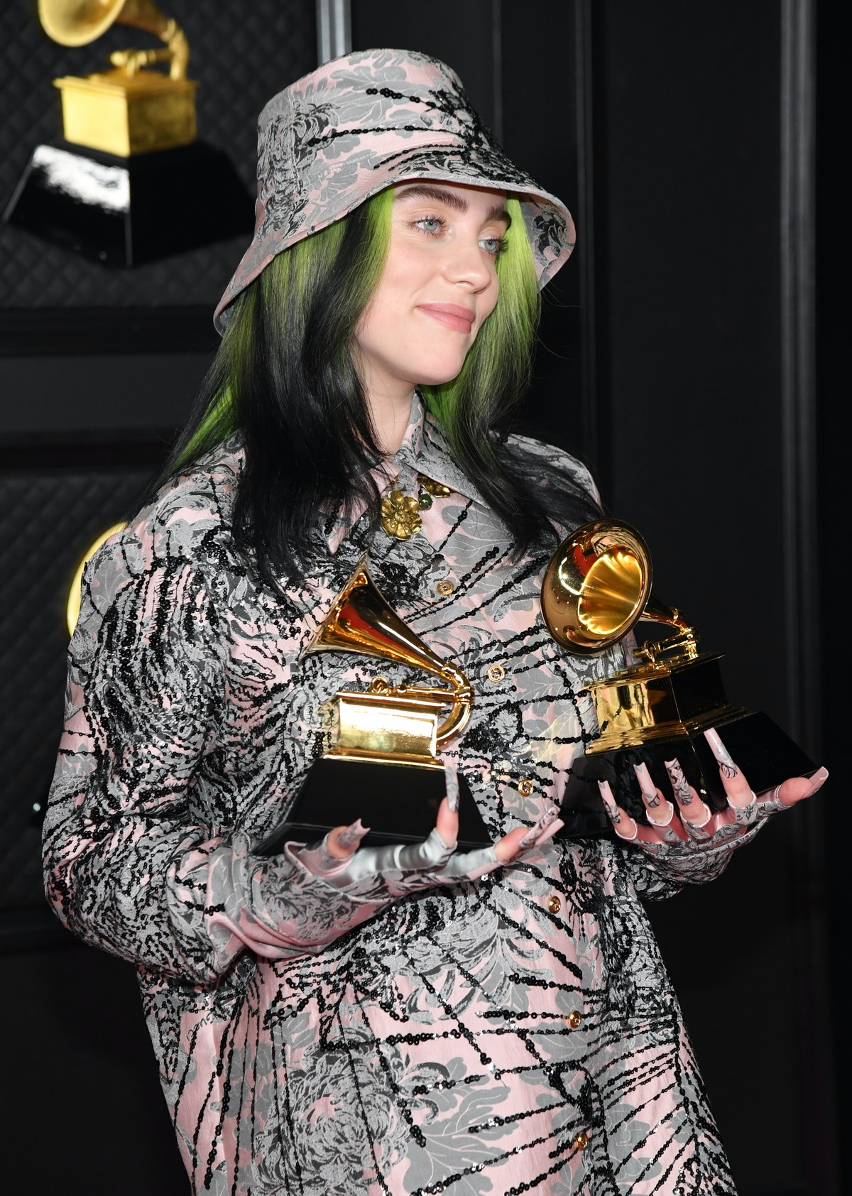 """LOS ANGELES, CALIFORNIA - MARCH 14: Billie Eilish, winner of Record of the Year for 'Everything I Wanted' and Best Song Written For Visual Media for """"No Time To Die"""", poses in the media room during the 63rd Annual GRAMMY Awards at Los Angeles Convention Center on March 14, 2021 in Los Angeles, California. (Photo by Kevin Mazur/Getty Images for The Recording Academy )"""