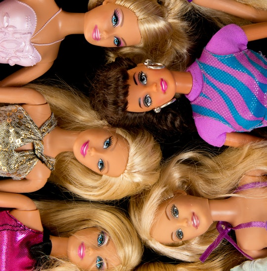 """""""Albuquerque, USA - June 15, 2012: Studio shot of a pile of Barbie fashion dolls. Barbie dolls are have been manufactured by Mattel, Inc. since1959. Barbie dolls are often a subject of criticisms since she promotes an unrealistic idea of body image for a young woman, leading to a risk that girls who attempt to emulate her look will become anorexic."""""""