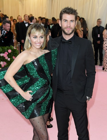 NEW YORK, NEW YORK - MAY 06: Miley Cyrus and Liam Hemsworth arrive for the 2019 Met Gala celebrating...