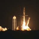 TOPSHOT - A SpaceX Falcon 9 rocket, carrying the Crew-2 mission astronauts, lifts off from launch complex 39A at the Kennedy Space Center in Florida on April 23, 2021. - SpaceX launched its third crew to the International Space Station an hour before sunrise Friday, recycling a rocket and spacecraft for the first time. The Crew-2 mission, the first involving a European, blasted off from the Kennedy Space Center in Florida at 5:49 am Eastern Time (0949 GMT). (Photo by Gregg Newton / AFP) (Photo by GREGG NEWTON/AFP via Getty Images)