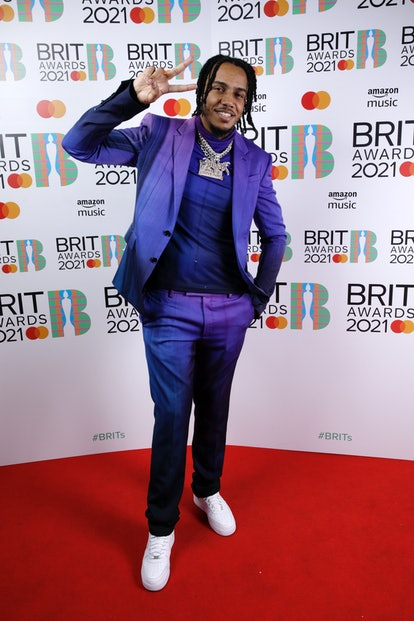 LONDON, ENGLAND - MAY 11: AJ Tracey poses in the media room during The BRIT Awards 2021 at The O2 Arena on May 11, 2021 in London, England. (Photo by JMEnternational/JMEnternational for BRIT Awards/Getty Images)