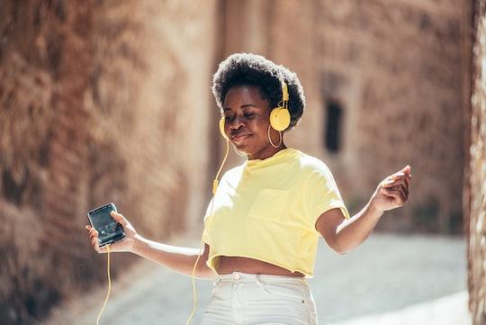 tween girl listening to headphones