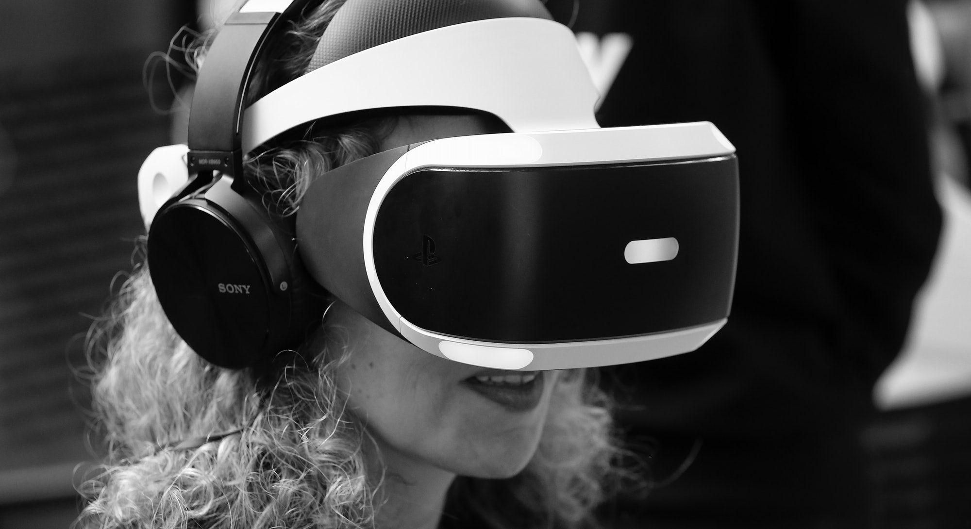 """PARIS, FRANCE - FEBRUARY 24:  A woman plays a video game with a virtual reality head-mounted headset 'Sony PlayStation VR' developed by Sony Interactive Entertainment during the show """"Virtuality Paris 2017"""" on February 24, 2017 in Paris, France. The first edition of Virtuality Paris, the virtual reality fair, will be held in Paris from 24 to 26 February 2017.  (Photo by Chesnot/Getty Images)"""