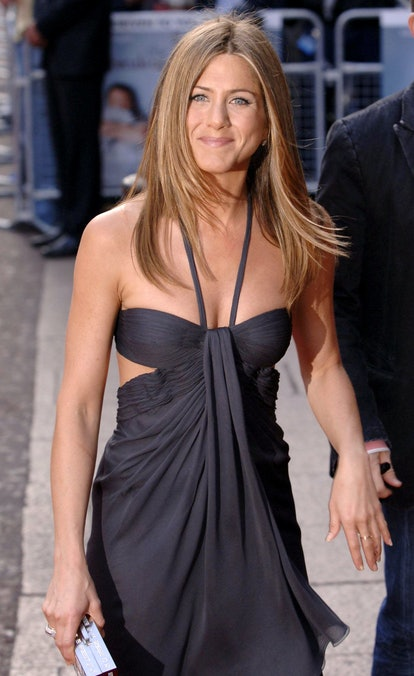 Jennifer Aniston wearing a gray dress with cutouts at the 2006 premiere of The Breakup.