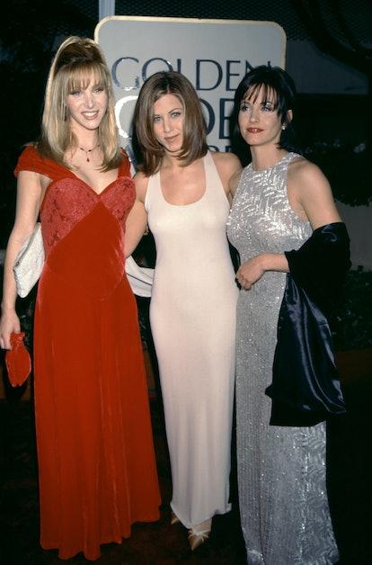 Jennifer Aniston wearing a nude tank dress at the 1996 Golden Globe Awards.