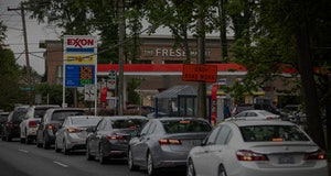 Motorists line up at an Exxon station selling gas at $3.29 per gallon soon after it's fuel supply wa...
