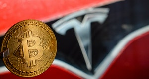 Illustrative image of a commemorative bitcoin in front of the Tesla car logo. Tesla, led by Elon Musk, confirmed that it purchased about $ 1.5 billion in bitcoin in January and expects to start accepting it as a payment in the future. On Monday, February 8, 2021, in Dublin, Ireland. (Photo by Artur Widak/NurPhoto via Getty Images)