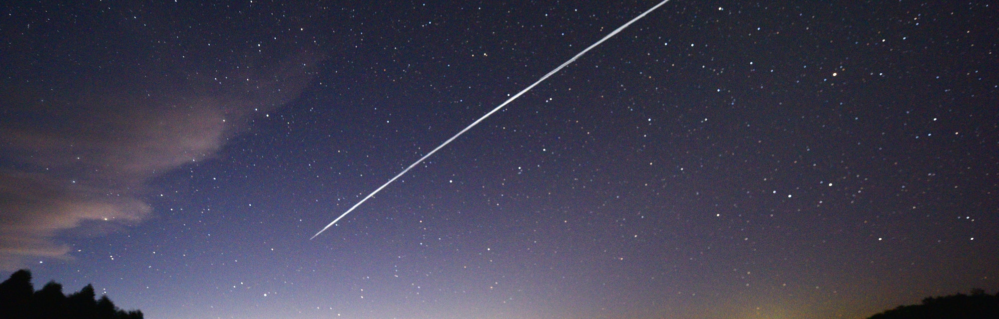 TOPSHOT - This long-exposure image shows a trail of a group of SpaceX's Starlink satellites passing over Uruguay as seen from the countryside some 185 km north of Montevideo near Capilla del Sauce, Florida Department, on February 7, 2021. (Photo by Mariana SUAREZ / AFP) (Photo by MARIANA SUAREZ/AFP via Getty Images)