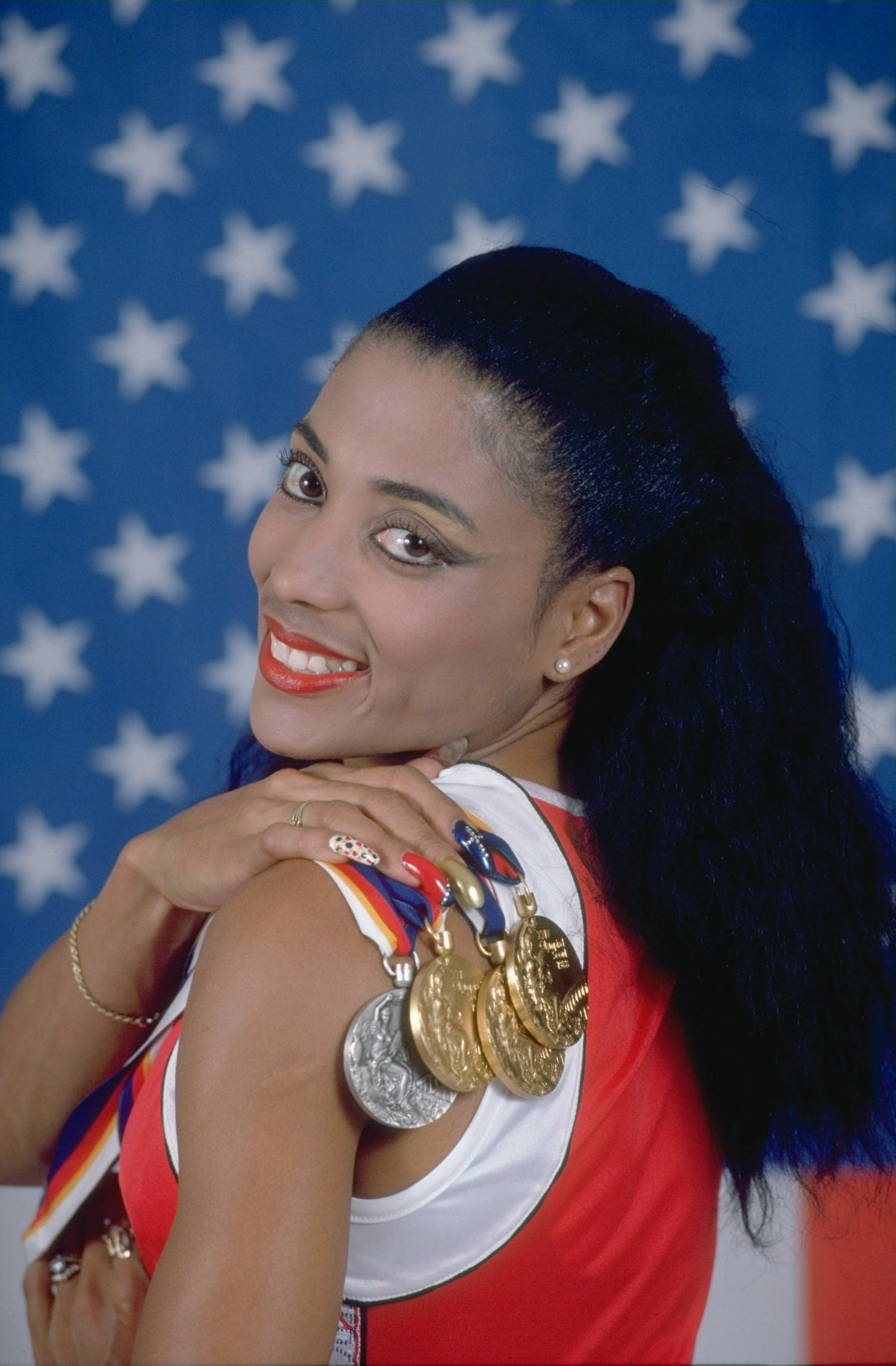 1998:  Florence Griffith Joyner of the United States displays her medals at the 1988 Olympic Games d...