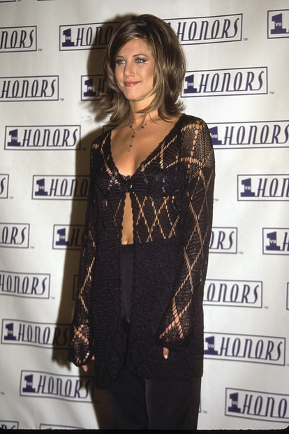 Jennifer Aniston wearing a crocheted top and bra at the 1995 VH1 Honors Event.