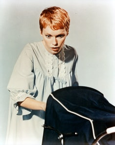 Mia Farrow looks into a carriage in publicity portrait for the film 'Rosemary's Baby', 1968. (Photo by Paramount/Getty Images)